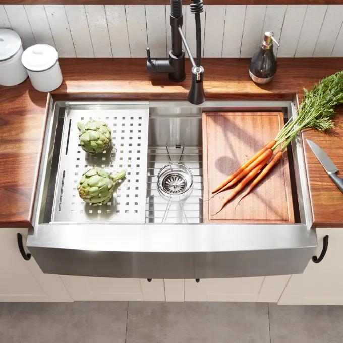 Included Colander, Cutting Board, and Sink Grid